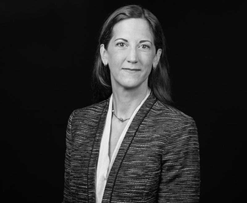 A black and white headshot of Meg Kammerud
